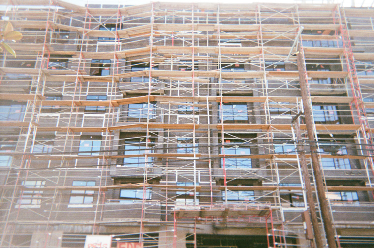 wood scaffolding forming a pattern against a building