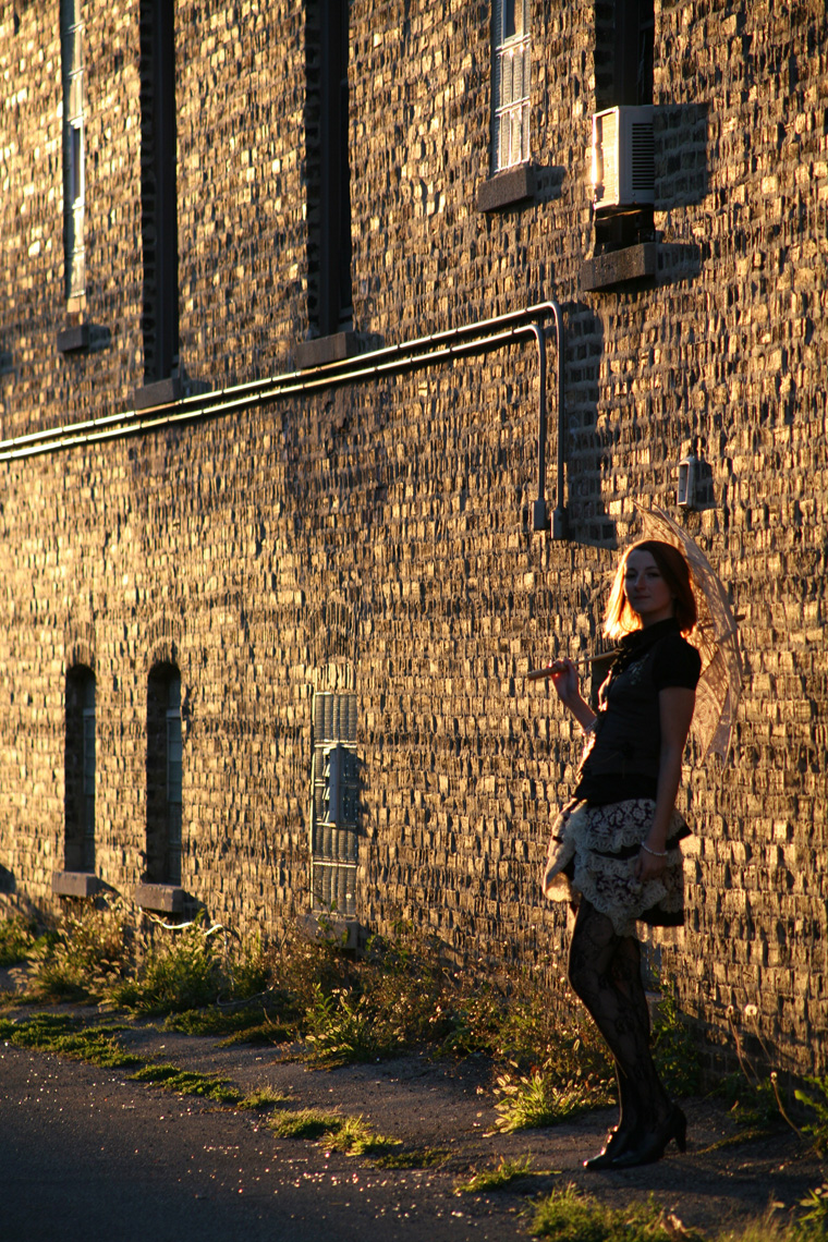 sunset against brick with lauren in steampunk